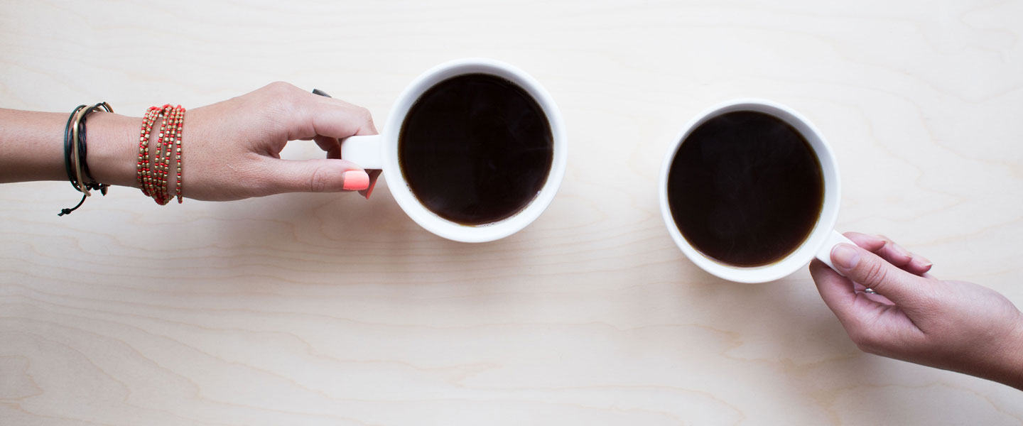Image of two hands holding coffee cups for FarOffice Limited
